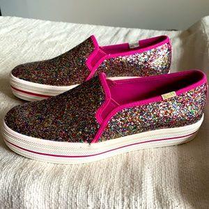 Keds x Kate Spade pink glitter slip on sneakers.